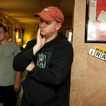 Former Army soldiers Victor Agosto, left, and Jeremy Hamilton watch news on television about the mass shooting in Fort Hood on Thursday, Nov. 5, 2009 at Under the Hood, a gathering place fre …