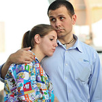 Daniel Clark hugs his wife Rachel Clark, left, while they wait for the closed base to re-open so they can get their 5-year-old child that is in day care in Fort Hood, Texas, after a shooting …