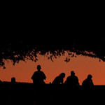 Soldiers and civilians stand on the back patio of the  Soldier Readiness Center at the Fort Hood Army post as the sun begins to set on the scene where Maj. Nidal Malik Hasan Hasan, a psychia …