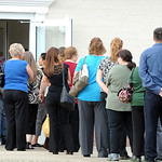 Mourners wait in line for a memorial service for homicide victim Catherine Hoholski at Cornerstone United Methodist Church in Elyria on Aug. 15.   Steve Manheim