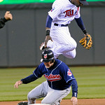 Cleveland Indians' Mike Redmond, bottom, is forced out at second by Minnesota Twins second baseman Orlando Hudson in the fifth inning on a double play hit into by Asdrubal Cabrera in a base …