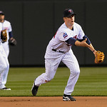Minnesota Twins first baseman Justin Morneau, right, tosses the ball to first for the out after fielding a ground ball off the bat of Cleveland Indians' Asdrubal Cabrera in the eighth inning …