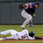 Cleveland Indians shortstop Asdruqal Cabrera, top, leaps over Minnesota Twins' Denard Span after the force at second on a double play hit into by Twins' Orlando Hudson in the first inning of …