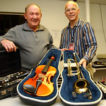 Steve Smith, left, owner of Pawn-N-Park on N. Ridge Rd, donates musical instruments to Mark Wainwright, lead instrumental music teacher for Elyria City Schools on Dec. 2.  Steve Manheim