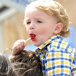 Robby Biggarts, 2, of Lorain, has a tootsie pop at the Lorain International Festival Parade on June 30.  Steve Manheim