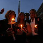 Mourners hold a candlelight vigil to remember Officer Jim Kerstetter.