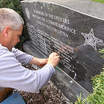 Officer Jim Kerstetter's name is added to a monument honoring fallen Lorain County law enforcement officers.
