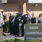 Mourners wait in line at Bauer-Laubenthal-Mercado Funeral Home in Elyria to pay respects to Officer Jim Kerstetter.