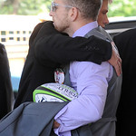 Sean Fox, front, Kevin's brother, gets a hug after from a wellwisher at the Kevin Fox' funeral at Cornerstone Chapel in Medina on June 9.  Steve Manheim