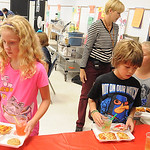 Third-graders at Redwood Elementary had a pizza and Italian soda party to celebrate Emilia Sansotta's winning artwork Tuesday.  Steve Manheim
