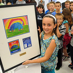 Emilia Sansotta, 8, a third grader at Redwood Elementary in Avon Lake, holds a plaque sent by the Torani,  of her Torani Raspberry winning label artwork,  at the school on Sep. 25.  Steve Ma …