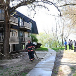 Lorain firefighters move a hose from an apartment fire at the Lakeview Apartments on W. Erie Ave. Apr. 22.   Steve Manheim