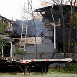 The scene of a fire that occurred in the overnight hours and killed three people in Lebanon, Ohio Monday, Oct. 19, 2009. Three adults died in the early morning blaze that engulfed a condemne …