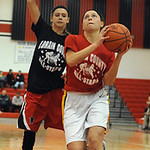 Gold team all star Brianna Shagovac of Amherst, right, goes to hoop past Black team Rachel Holowecky of Firelands in game 2 of Lorain County All Star girls at Elyria on Mar. 19. Steve Manhe …