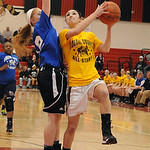 Orange team all-star Anelisa Kollias of Avon Lake goes to hoop over Blue team all-star Katelynn Baker of Clearview in game 1 of Lorain County Girls All-Star Game at Elyria on Mar. 19. Stev …
