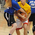 Orange team Tori Odle of First Baptist, right,and Blue Team Katelynn Baker of Clearview fight for the ball in Lorain County Girls All Star Game Mar. 19.  Steve Manheim