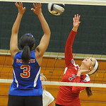 Erika Ruffner of Firelands hits over Open Door 3 Briana Rodgers in game 1 of Lorain County All Star Volleyball on Nov. 14.   Steve Manheim