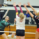 EC 2 Catherine O'Shaughnessy hits past Avon Lake 13 Isabelle Wagner and Brookside's Shelby Kerstetter in game 2 of Lorain County All Star Volleyball on Nov. 14.   Steve Manheim
