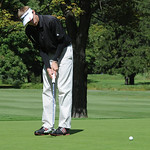 Kevin Koepp of Elyria putts on green in the Lorain County Coaches tournament at Columbia Hills on Sep. 19.   Steve Manheim