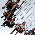 Kids ride the YoYo at the Lorain County Fair Aug. 24.  Steve Manheim