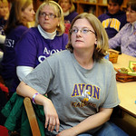 Kate Lenz, front, and Laura Menzing watch results tally on the screen at a meeting of the Avon Levy support committee on election night at Avon Middle School Nov. 2.    Steve Manheim
