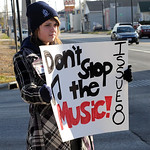Lorain High student Noelle Chesnick holds a sign in support of Issue 8 for Lorain schools at E. 21st and Broadway Nov. 2.