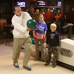 New County Commissioner Tom Williams throws a ball as he celebrates his win. In the background are his children Rachel Williams, 10 and Trent Williams, 6, who spent almost 4 hours during the …
