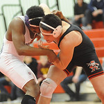 Elyria Kevin Villa, right, and Lorain George Colvin in 152 wt. class quarterfinals Jan. 23. Steve Manheim