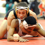 Elyria Darrion Overall defeats Lorain Xavier Edwards in 126 wt. class quarterfinals Jan. 23.  Steve Manheim