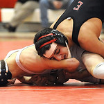 Elyria Armando Torres defeats Lorain Markus Cruz in 113 wt. class quarterfinals Jan. 23. Steve Manheim