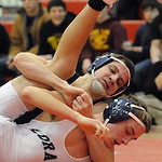 Elyria Brandon Egnor, rear, defeats Lorain Tevin Wagner in 132 wt. class quarterfinals Jan. 23.  STeve Manheim