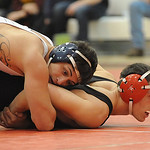 Lorain Eli Garcia, left, defeats Elyria Alex Parker in 145 wt. class quarterfinals Jan. 23 . Steve Manheim