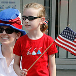 Jennifer Lang (in hat) and daughter Morgan Lang age 7 were thoroughly enjoyin the elyria Parade. Elyria Parade.  Photo by Tom Mahl
