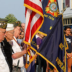 Ceremony lowering the flag to half mast for Memorial Day. This took place in Exchange Park in Vermilion. Photo by Tom Mahl
