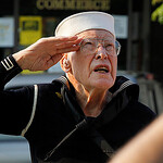 Ceremony lowering the flag to half mast for Memorial Day. This took place in Exchange Park in Vermilion. This sailor is Luther Marquert age 93 (uniform still fits). Photo by Tom Mahl