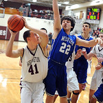 Wellington Dylan Weidrick puts up shot over Midview Steven Gott in first half Dec. 4.   Steve Manheim