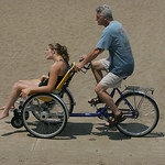 29JUN12   Samantha Taylor and her dad Aaron in a Duet, a hybrid wheel chair and bicycle her family purchased.         Photo  by Chuck Humel