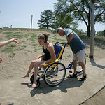29JUN12   Samantha Taylor and her dad Aaron in a Duet, a hybrid wheel chair and bicycle her family purchased. The rear drive part detaches from the wheel chair.        Photo  by Chuck Humel