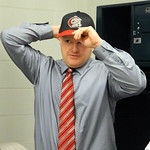 Jeff Isom puts on a cap fter being named the new Crushers manager at All Pro Freight Stadium on Dec. 19. Steve Manheim