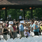 Mid-morning and parents, relatives and friends of graduates are shielding themselves from the sun at the Oberlin College commencement exercises. photo  by Chuck Humel