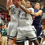 EC 32 John Stursa, 40 Xavier Bennett and Oberlin's  Marvin Jackson go up for rebound in first half Jan. 15.  Steve Manheim
