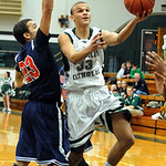 EC Ceeven Shelton goes up to hoop past Oberlin Marcus Bailey Jan. 15.  Steve Manheim
