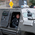 Seattle Police dept. SWAT team members leave in their vehicle from the area in Seattle where they believed the suspect in the killing of four police officers in Parkland, Wash., was located  …