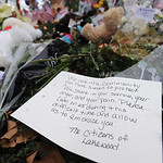 A letter is left at the memorial site at the Lakewood Police Department Monday, November 30, 2009.  (AP Photo/The News Tribune, Lui Kit Wong)