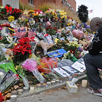 Eugene Jones of Lakewood prays for the four slain Lakewood police officers  at the memorial site at the Lakewood Police Department on Monday, Nov. 30, 2009.  (AP Photo/The News Tribune, Lui  …