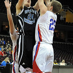 Open Door's Andrew Patterson shoots over CCA Daneil Bennett in first half at Quicken Loans Arena on Jan. 2.  Steve Manheim