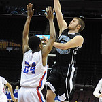 Open Door's Zach Thomas shoots over CCA Tyrez Shephard in first half at Quicken Loans Arena on Dec. 2.  Steve Manheim