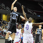 Open Door's Drew Zaborowski shoots over CCA Bryan Gee, and Gregory Oliver 5 in rear,  in first half at Quicken Loans Arena on Jan. 2.   Steve Manehim