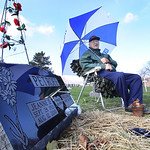 19nov10 bishop— William Petroff sits by his wifes grave during the 11 oclock hour. It's one of the two times a day that he makes the trek to keep his wife company. He uses the golf umbrell …