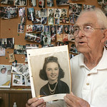 10NOV10 William Petroff, a widower who sits by his wife Jeanne's grave every day, took the CT through decades of memorabilia in his N. Ridgeville home. He's holding a picture of his wife Jea …